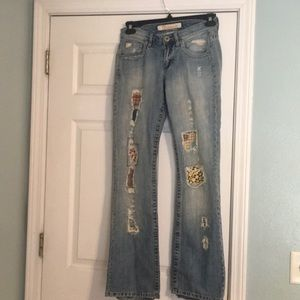 Distressed/patchwork jeans